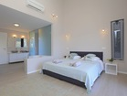 Bedroom with en suite bathroom - with a sea view