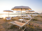 Deckchairs with sunbrellas at Baska town beach - vacation house Sunny Rock, Krk Island