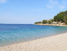 Relax and dip your feet in the turquoise sea at Murvica beach.