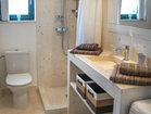 Hvar Serenity Apartments - bathroom with shower and washing machine.