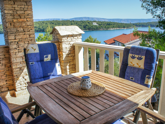 Hvar Serenity Apartments - beautiful terrace with 4 chairs and table overlooking the sea.
