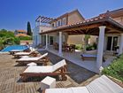 Luxury villa by the sea - pool terrace with loungers
