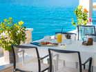 Boutique hotel by the sea - the covered outdoor terrace offers perfect protection from the heat